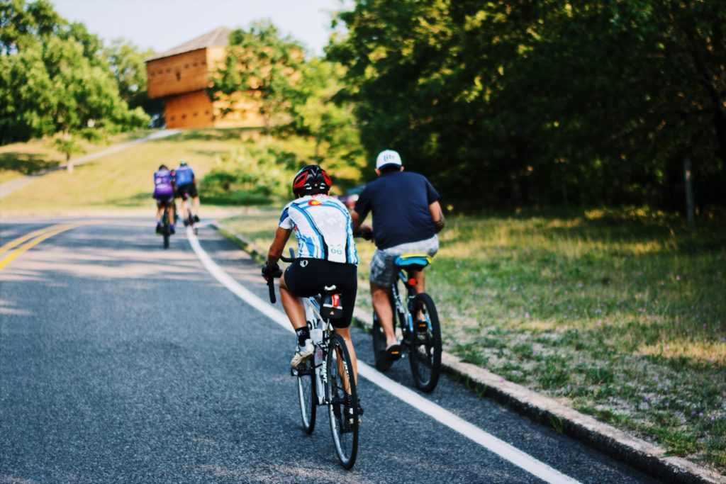 Cyclists riding by the Block House