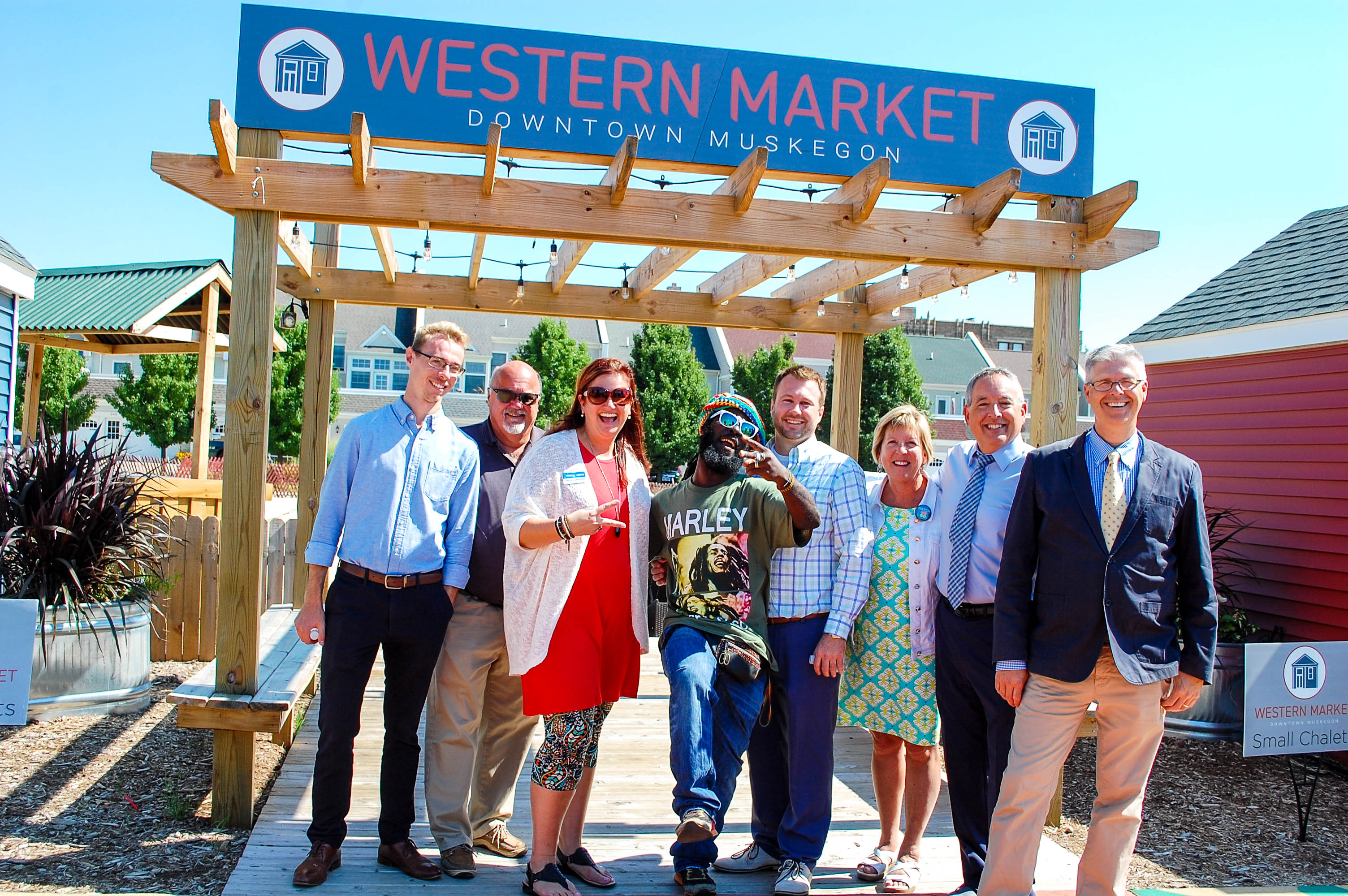 Chamber staff with Chuck Marohn and others at the Western Market in Downtown Muskegon