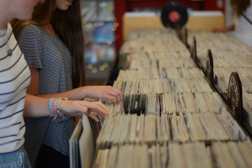Two girls shopping for records