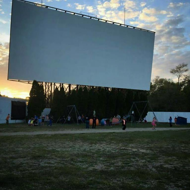 Photo of the Getty Drive-In movie theatre at dusk.