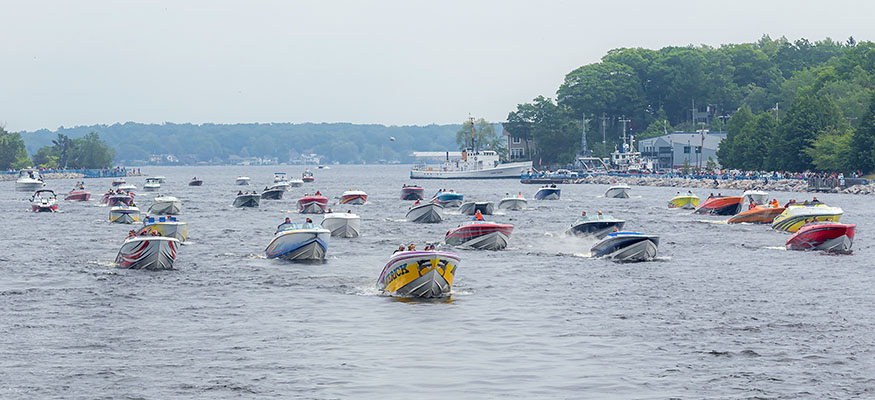 Boats heading out of Muskegon Lake and towards Lake Michigan through the Muskegon Channel.